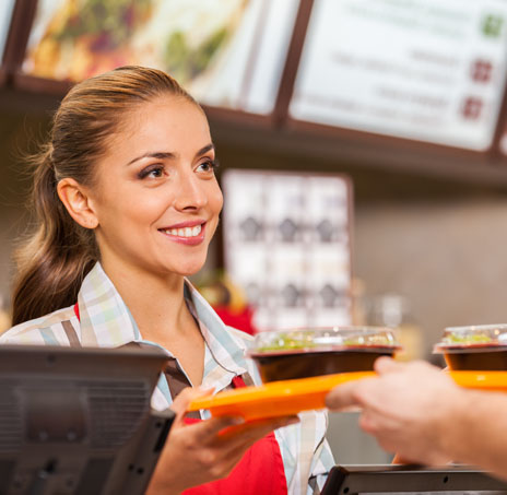Woman in Front of a Cash Register